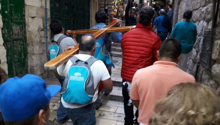 Maryknoll Fathers and Brothers Mission Educator Promoter, Dr. Walter Hidalgo, participates in the Stations of the Cross in Jerusalem, Israel.